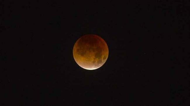 Blood moon is a non-scientific term used to refer to the red tinge on a fully eclipsed moon - Sakshi Post
