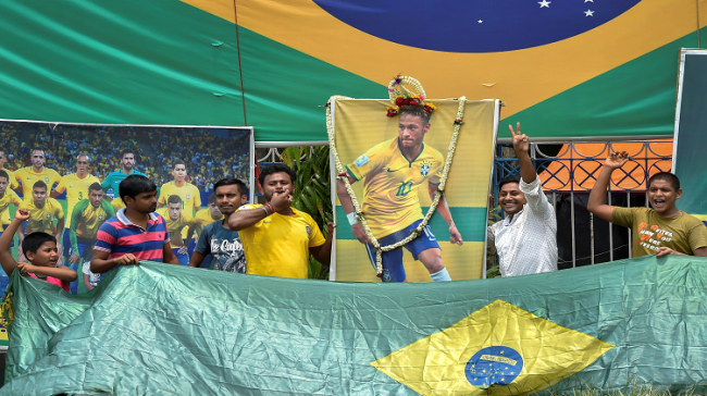 Brazilian football team supporters cheer for footballer Neymar Jr. ahead of a match against Mexico during FIFA World Cup 2018 - Sakshi Post