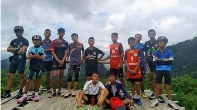A group of 10 soldiers will remain with the 12 children and their coach trapped in a partially flooded cave in Thailand - Sakshi Post