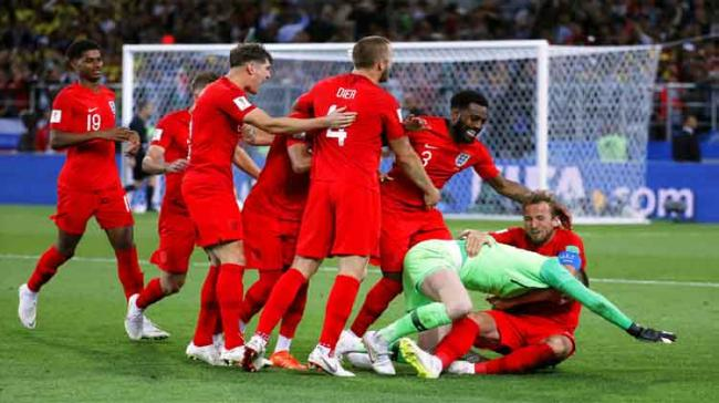 England edged Colombia 4-3 on penalties to halt a run of five successive shootout defeats at major tournaments and book a quarter-final clash against Sweden - Sakshi Post