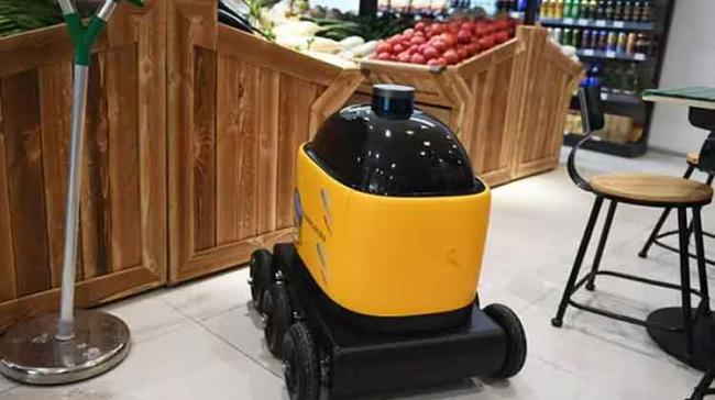 The yellow robot by Zhen Robotics delivers products from the supermarket to houses - Sakshi Post