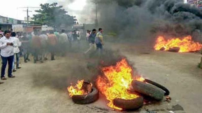 Agitators had clashed with the police and torched vehicles at several places - Sakshi Post