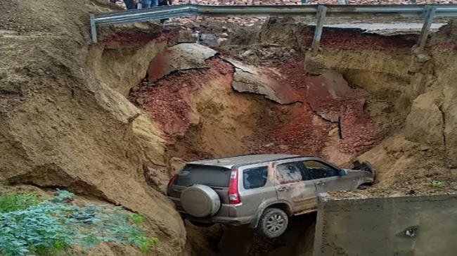 An SUV plunged 15-20 feet after a service road caved in alongside the Agra-Lucknow expressway - Sakshi Post