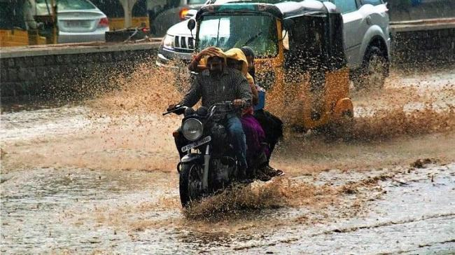 Normal life was thrown out of gear at different places in Telangana today as heavy rains lashed many parts of the state - Sakshi Post