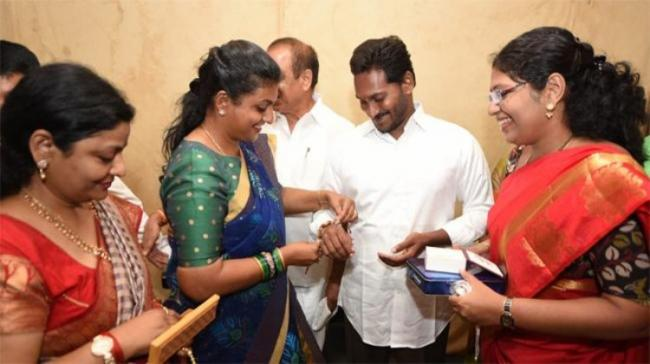YSRCP MLA tying Rakhi to party President YS Jagan Mohan Reddy - Sakshi Post
