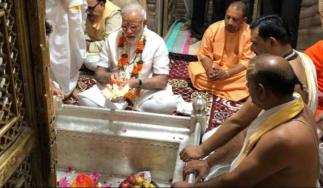 Narendra Modi signed off his 68th birthday with a visit to the famous Shiva temple Kashi Vishwanath - Sakshi Post