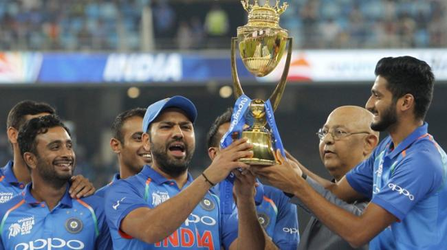 India defeated West Indies by five wickets in the first T20 International here Sunday - Sakshi Post