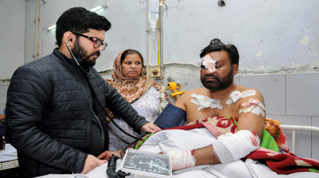 An injured victim being treated at a hospital in Amritsar after two men on a motorcycle reportedly threw a grenade at the Nirankari Bhawan in Amritsar - Sakshi Post