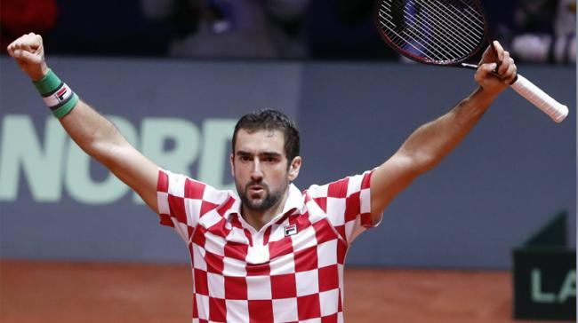 Marin Cilic defeated Jo-Wilfried Tsonga 6-3, 7-5, 6-4 in the second singles match to give Croatia a commanding 2-0 lead over France - Sakshi Post