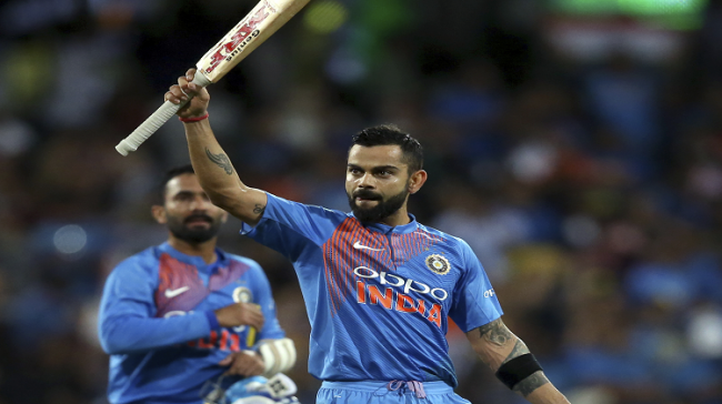 Virat Kohli waves his bat to the crowd as he celebrates his teams six wicket win over Australia in their Twenty20 cricket match in Sydney - Sakshi Post