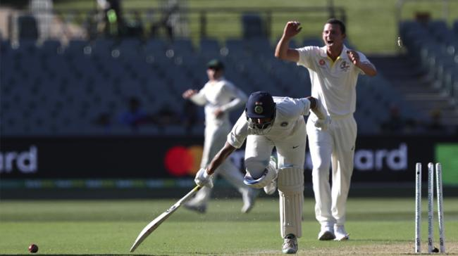 Cheteshwar Pujara is run out during the first cricket test between Australia and India - Sakshi Post