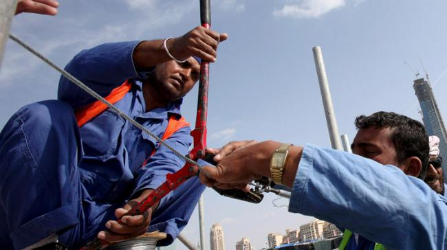 Indian Workers in Gulf (Credit:Reuters.) - Sakshi Post