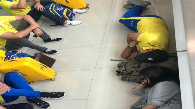 Mahendra Singh Dhoni posted a picture of him sleeping on the floor of an airport - Sakshi Post