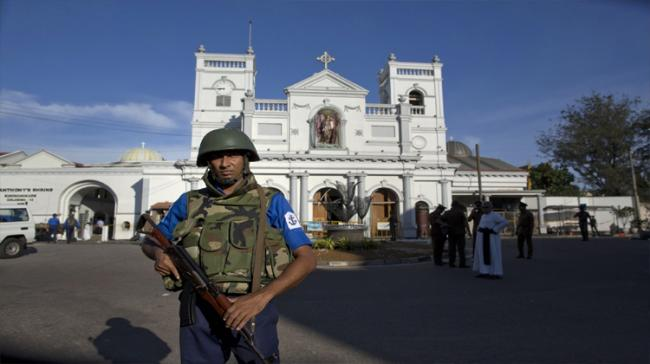 Sri Lankan air force officers and clergy stand outside St. Anthony's Shrine - Sakshi Post