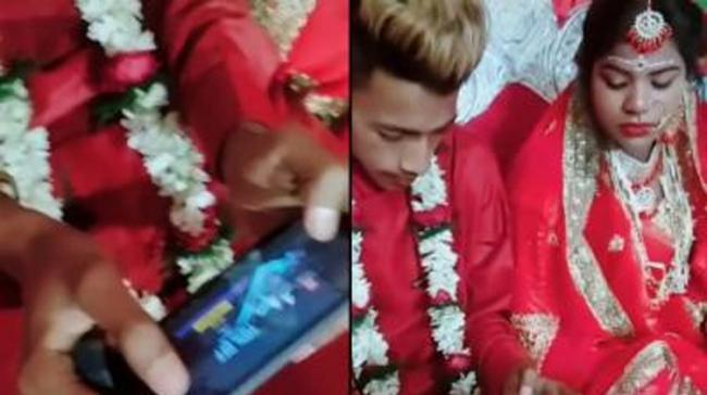 the groom is seen busy playing PUBG at his own wedding. - Sakshi Post