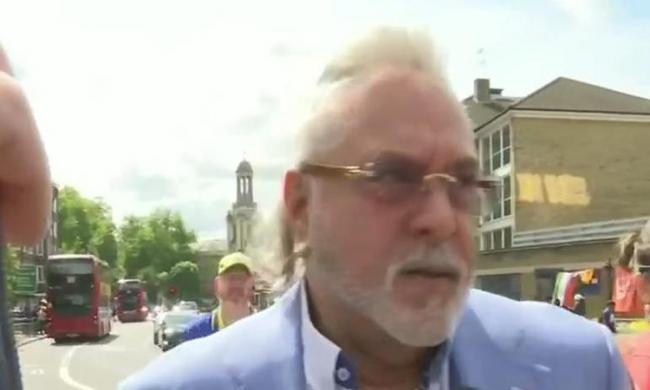 Embattled liquor tycoon Vijay Mallya on Sunday joined hundreds of cricket fans for the India versus Australia ICC Cricket World Cup match at The Oval - Sakshi Post