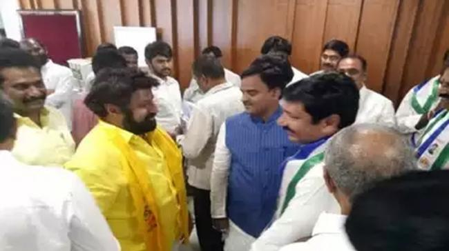 Starting afresh: Affectionate hugs, warm handshakes, and friendly banter marked the first day of Assembly sessions. TDP MLA Balakrishna sharing a lighter moment with YSRCP legislators - Sakshi Post