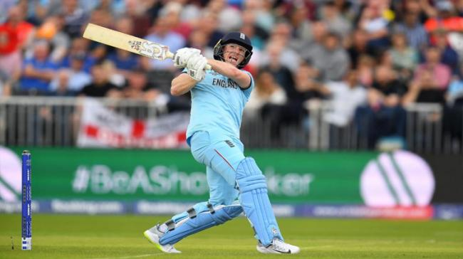 Captain Eoin Morgan smashed a world record 17 sixes in his 71-ball-148, firing England to a gigantic 397 for 6 against Afghanistan in a World Cup game - Sakshi Post