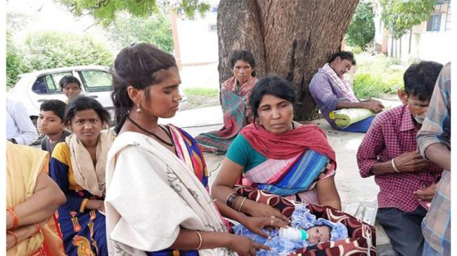 The new born baby with the deceased's family members - Sakshi Post