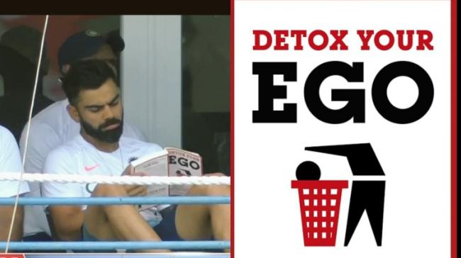 Kohli was spotted reading 'Detox Your Ego: Seven Easy Steps to Achieving Freedom, Happiness and Success in Your Life' by Steven Sylvester. - Sakshi Post