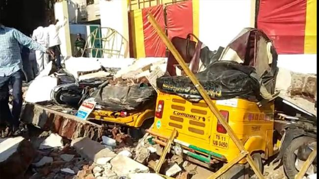 Vehicles damaged after function hall wall collapsed - Sakshi Post