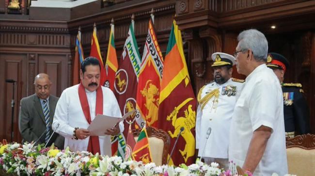 Sri Lanka's former President Mahinda Rajapaksa was sworn in as the island country's 23rd Prime Minister in the presence of President Gotabaya Rajapaksa - Sakshi Post