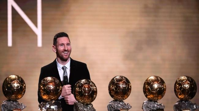 Lionel Messi reacts after winning the Ballon d'Or France Football 2019 trophy - Sakshi Post