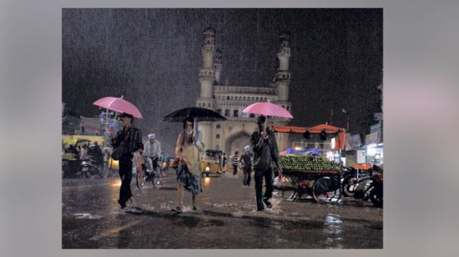 Though the rains last night surprised the citizens of Hyderabad, it prompted many residents to slip into their winter wear! - Sakshi Post