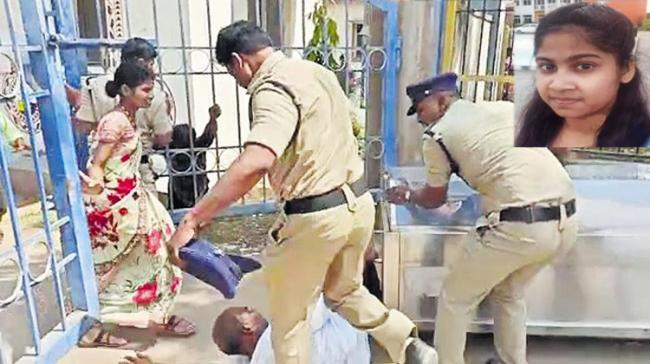 Screen grab of constable kicking the girl's father - Sakshi Post