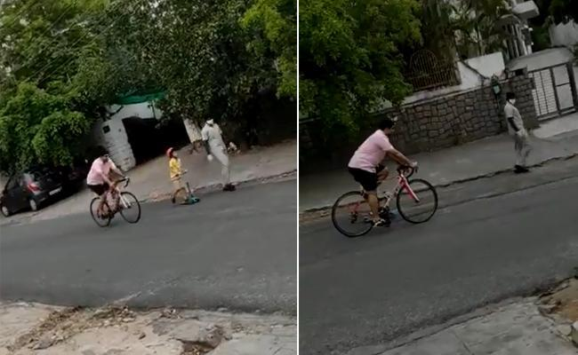 Nara Lokesh  freewheeling on a bike with his son Devansh on in tow on a skateboard and roaming the streets - Sakshi Post
