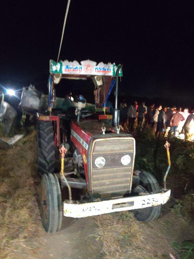 The tractor which had hit a electric pole - Sakshi Post