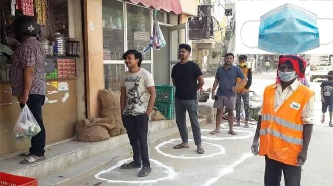 People standing in front of a shop - Sakshi Post