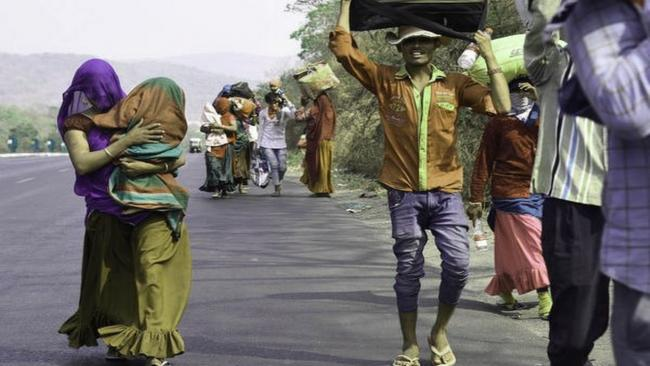 Migrants on road (File Image) - Sakshi Post