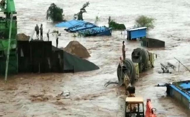 Asifabad: Rescue Operations On to Save Workers Stranded In Flood Waters - Sakshi Post
